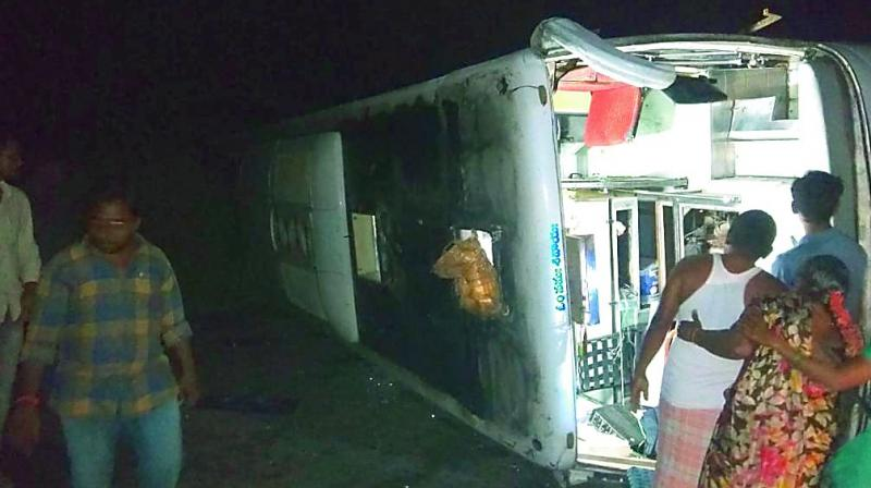 A private bus overturned at Laxminagaram in Khammam district in the wee hours of Monday. (Photo: DC)