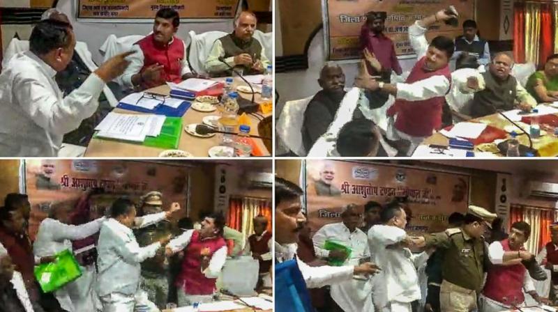 A combo of photos shows BJP MP from Sant Kabir Nagar Sharad Tripathi in a scuffle with Mehdawal MLA Rakesh Baghel during a planning committee meeting in Sant Kabir Nagar, Uttar Pradesh, on Wednesday. (Photo: PTI)