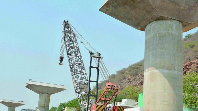 Kanakadurga flyover works in progress at One Town in Vijayawada.