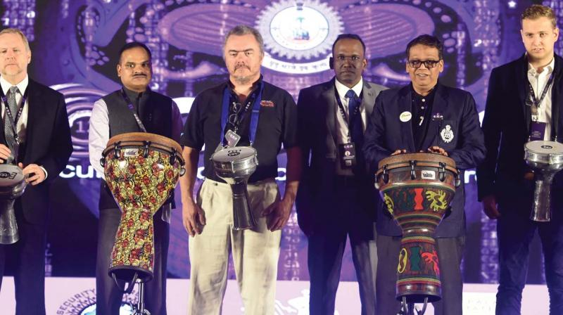 State Police Chief Loknath Behra inaugurates the Cocon 2019 by beating drums along with other guests in Kochi on Friday.   (SUNOJ NINAN MATHEW)