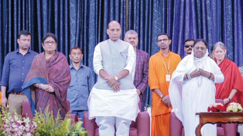 Defence Minister Rajnath Singh with Matha Amritanandamayi in Amritapuri.