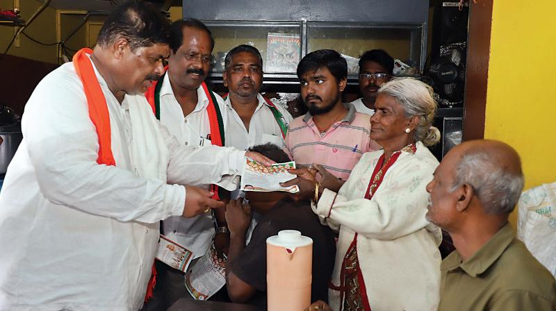 Disqualified MLA and BJP candidate K. Gopalaiah campaings in Mahalakshmi Layout on Wednesday
