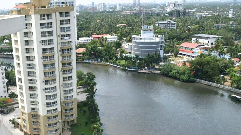 Mapping of river bank structures is one of the parameters that must be incorporated into computer models to prepare simulation models. One of the five buildings the Supreme Court has ordered to demolish for violating coastal zone regulations in Kochi. (Photo: DC)