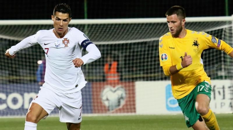 Portugal captain Cristiano Ronaldo took his international tally to 93 goals when he scored four times to give the European champions a 5-1 win away to Lithuania in their Euro 2020 qualifier on Tuesday. (Photo:AFP)