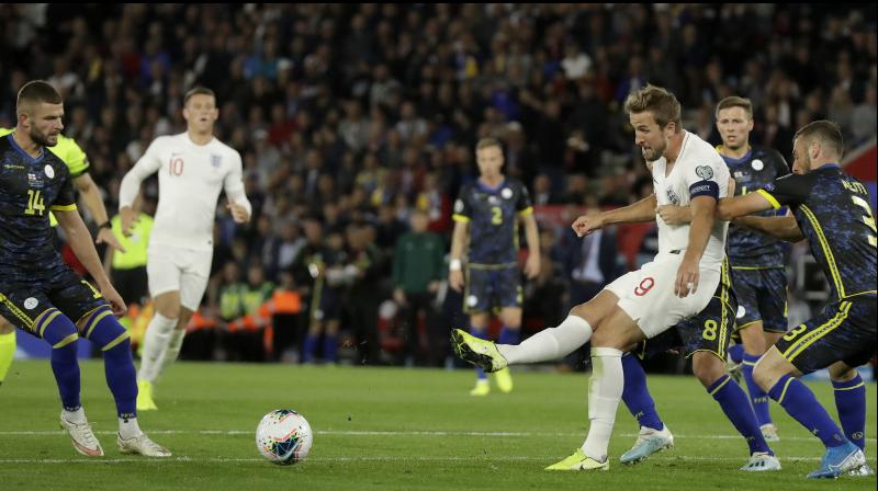 Harry Kane, who scored England's second goal, had a penalty saved by Arijanet Muric and Sterling then hit the post but Kosovo were still going forward until the final whistle and Bersant Celina went close to making it 5-4. (Photo:AP)