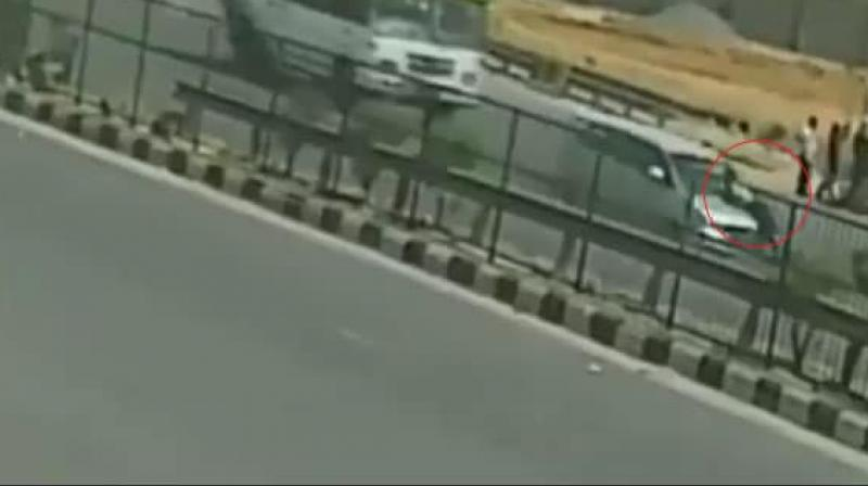 A car driver dragged a toll plaza employee for a long 5-6 km on his car's bonnet at the speed of about 100km/hr in Gurugram when asked to stop at toll plaza on Saturday. (Photo: Screengrab)