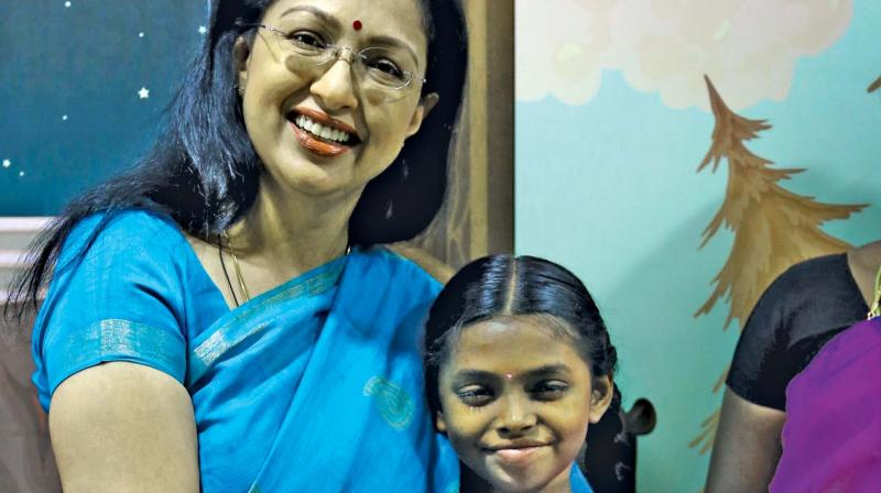Gautami gifts a cancer afflicted child.