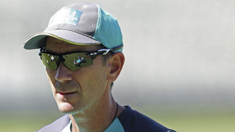 Australia coach Justin Langer claims there is a worldwide problem with ball-tampering, partly due to unresponsive pitches, while vowing it will never happen under his watch. (Photo: AP)