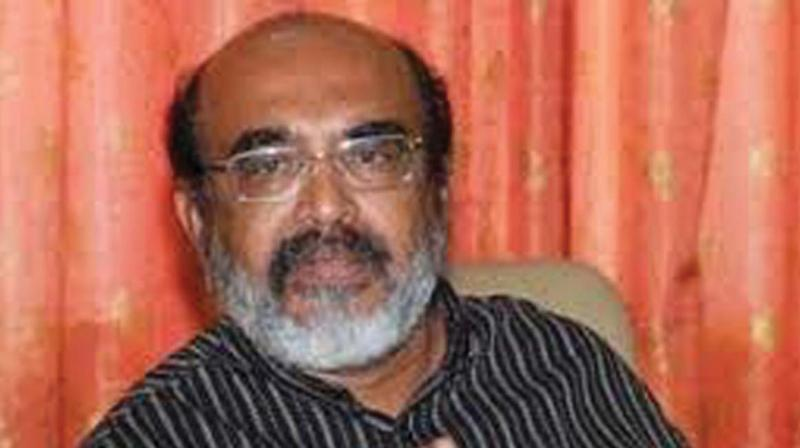 Finance minister Dr T M Thomas Isaac