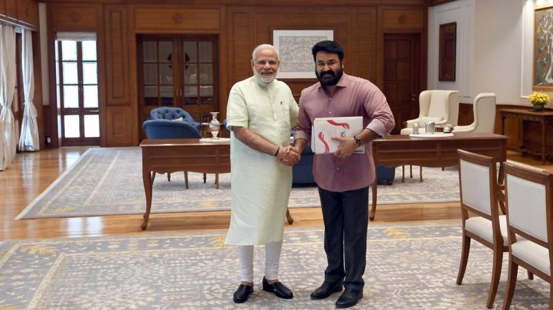 Malyalam superstar Mohanlal met Prime Minister Narendra Modi on Monday to brief him about the social works his organisation is carrying out.