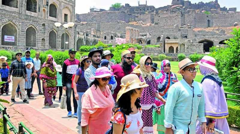 Tourists visit Golconda Fort on the occasion of World Heritage Day on Thursday.  (Photo: P. Surendra)