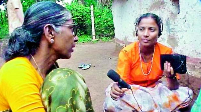 General Narsamma and Algole Narsamma interviewing residents of a village for their radio shows. V. Sadanandam focuses on corruption and police harassment and Narsimha Reddy reports on farmers' distress.