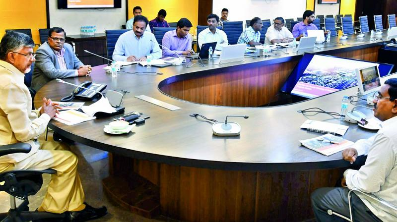 Chief Minister N. Chandrababu Naidu holds a review meeting with CRDA officials at Velagapudi on Thursday. 	(Photo: DC)