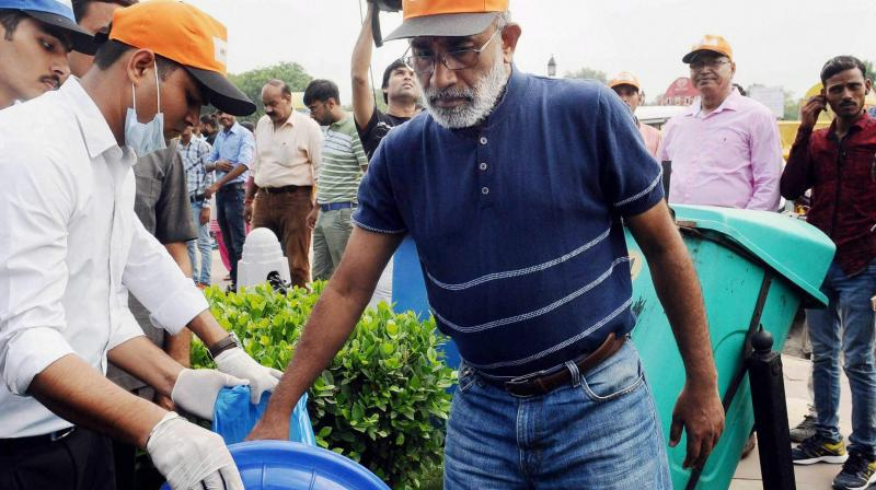 Minister of State for Tourism (I/C) and Electronics & Information Technology, Alphons Kannanthanam participating in a cleanliness drive as part of 'Swachhta Hi Sewa' campaign, organised by Ministry of Tourism, in New Delhi on Sunday. (Photo: PTI)