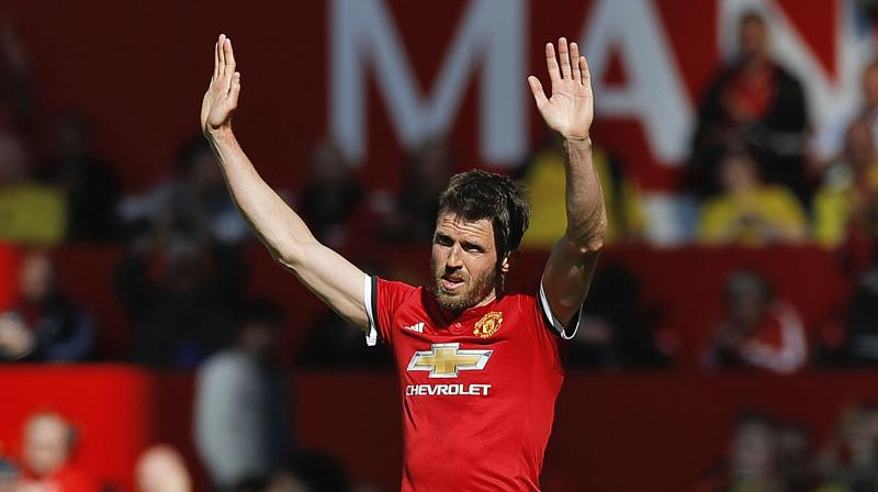 Carrick makes quick switch to coaching role at Man Utd