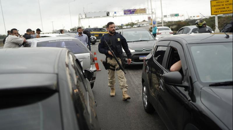The hostage situation began at around 6:30 am local time on Tuesday when the gunman seized the vehicle with 37 people onboard as it was crossing the Rio-Nitero bridge. (Photo: AP)