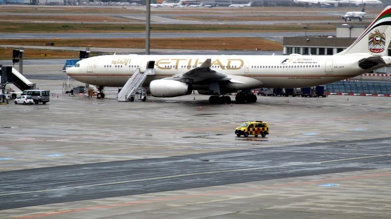 He climbed the fence and sneaked on to the runway, to try and enter a plane (Photo: AFP)