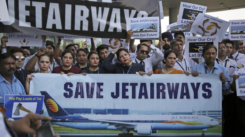 Jet Airways employees on Monday held a protest here at Town Hall, appealing the Central government to save the private airline. Nearly, 500 Jet Airlines employees including all ground handling staff, cabin crew members, administration and sales team took part in the protest here. Jet Airways on April 17 cancelled all flights, including its international flights temporarily after failing to secure emergency funds from its lenders, according to a statement by the airlines. (Photo: AP)