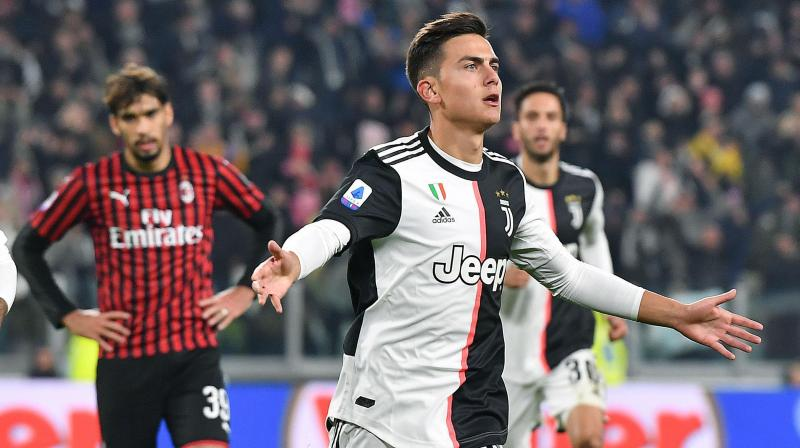 Juventus stayed top of Serie A with a 1-0 win over AC Milan thanks to Paulo Dybala's fine strike on Sunday after Cristiano Ronaldo was substituted for the second game in a row and walked straight down the tunnel, clearly unhappy at the decision. (Photo:AP)
