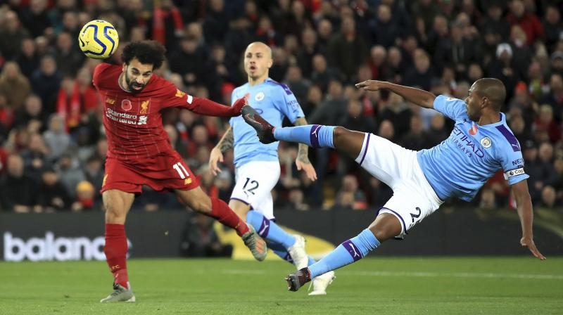 The victory, sealed with goals from Fabinho, Mohamed Salah and Sadio Mane, leaves unbeaten Liverpool on 34 points from 12 games, eight ahead of Leicester City and Chelsea, and nine in front of Pep Guardiola's fourth-placed City. (Photo:AP/PTI)