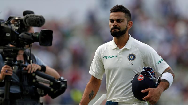 "After Joe Root and co's win in Birmingham Test, some of the England cricket team fans mocked the Indian cricket, dancing before the team bus, singing, Where is your Virat Kohli gone"". (Photo: AFP)"