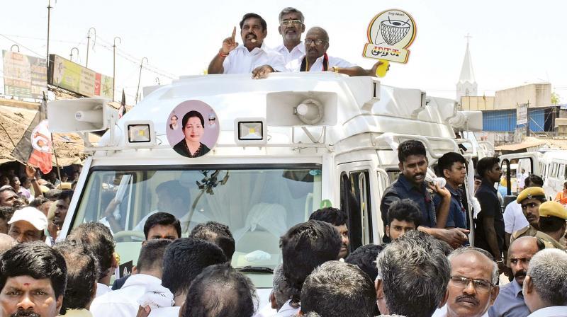 Chief Minister Edappadi K. Palaniswami campaigning for the Tiruchy Lok Sabha DMDK candidate Dr.Elangovan near Gandhi Market area in the city on Monday. State tourism minister Vellamandi Natarajan is also seen.(Photo: DC)