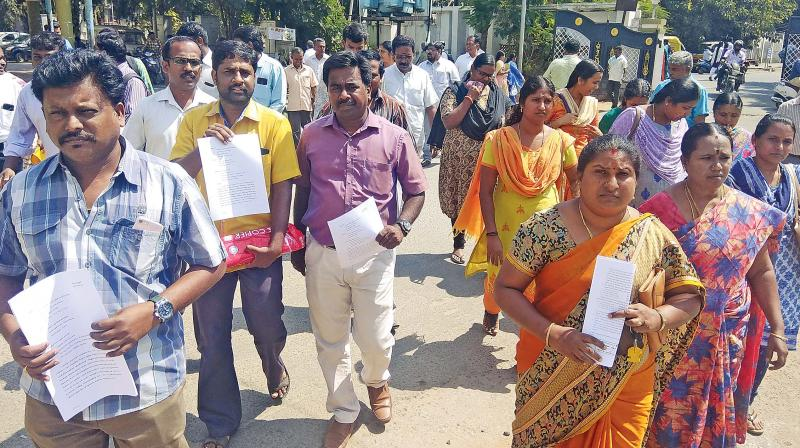 Parents with copies of the petition they submitted to the collector on Monday. (Photo:  DC)