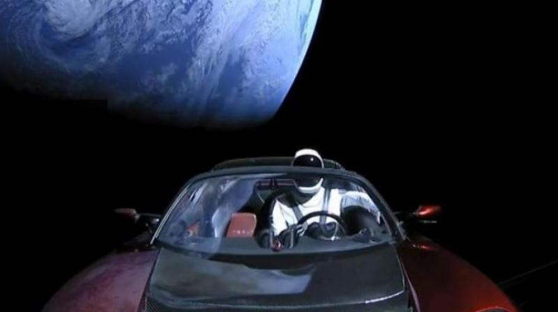 The image shows the company's spacesuit in Elon Musk's red Tesla sports car which was launched into space during the first test flight of the Falcon Heavy rocket.