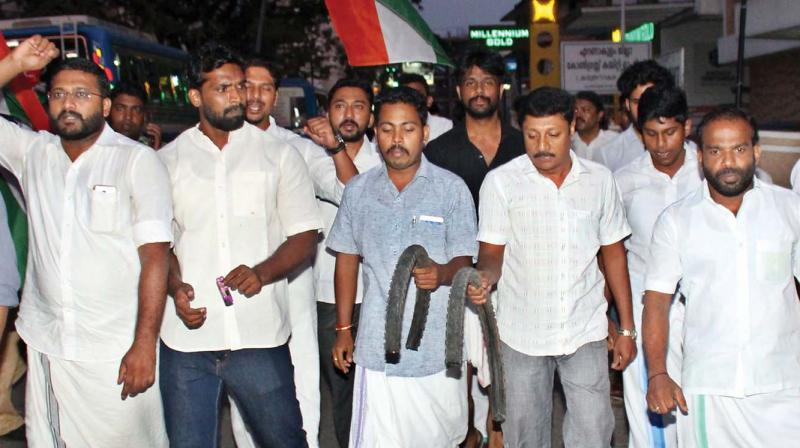 Youth Congress activists take out a march to protest the killing of Shuhaib in Kochi on Tuesday.