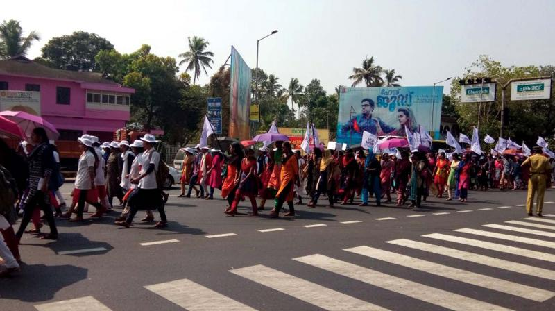 Nurses under UNA take out a rally on the National Highway in front of KVM hospital Cherthala on Thursday.