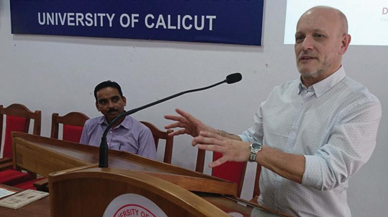 Prof. Fabio Parasecoli of New York University speaks at the 'History of food' seminar organised by the department of history on Calicut University campus on Tuesday.