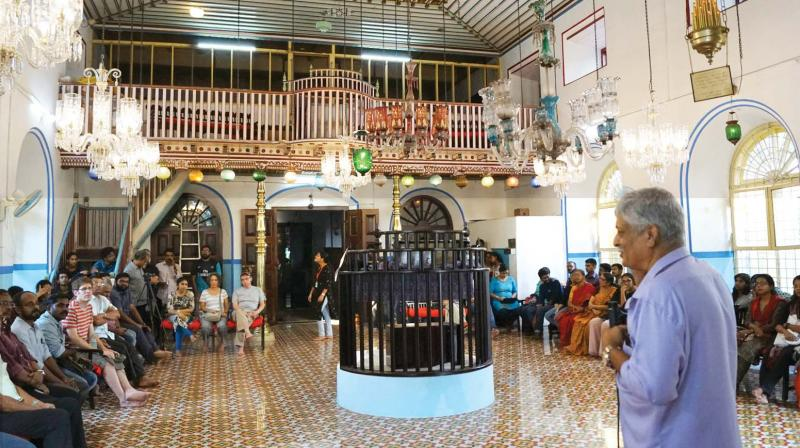 People listen to history of Jews at the India Heritage Walk Festival 2018 at Kadavumbagham synagogue.