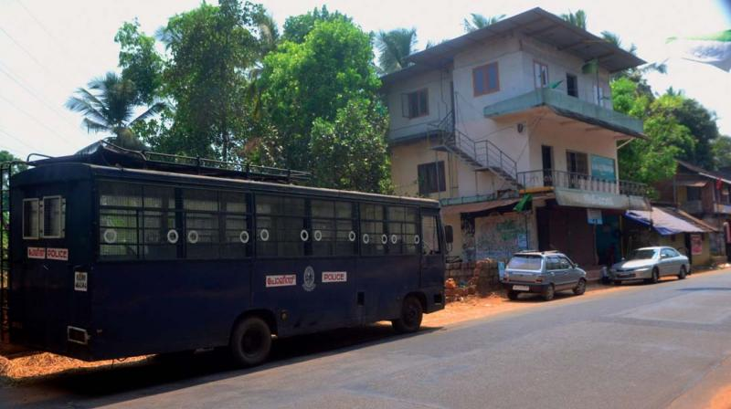 Police bus gives cover for the T.P. Chandrasekharan memorial column
