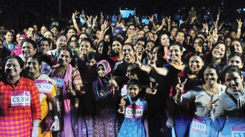Women participate in the 'Shethone' night run at SM Street (Photo: Venugopal)