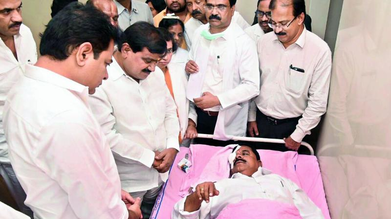 Council Chairman Swamy Goud being treated by doctors after he was injured in the assembly. KTR and others rush to Sarojini Devi eye hospital to enquire about his health condition. (Photo: BHMK Gandhi)