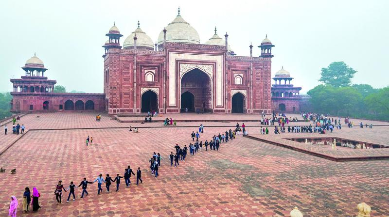 Students line up in front of the mosque from the main tomb of Taj Mahal, Agra. Photographer Prathap DK