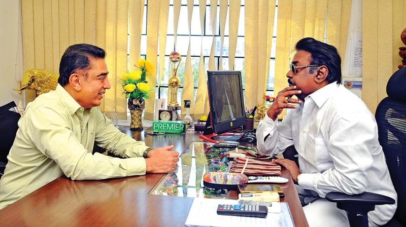 Actor-politician Kamal Haasan meets DMDK party founder Vijayakanth at his office on Monday.