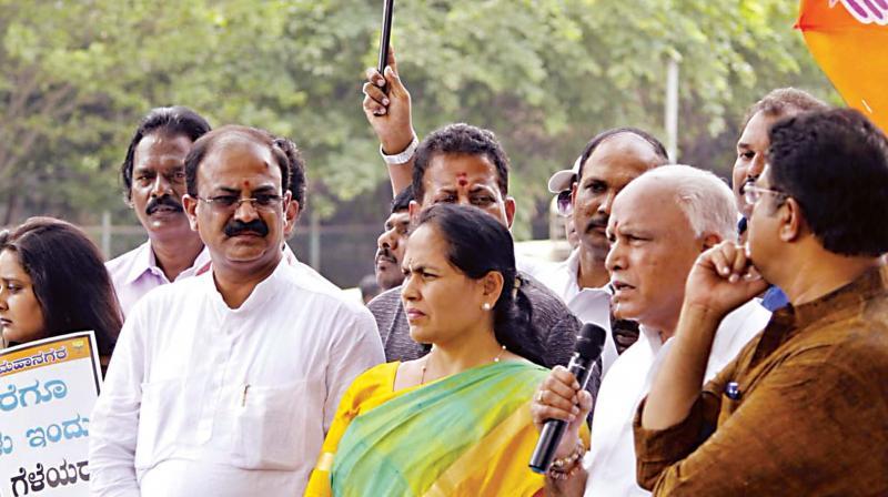 A file photo of Mahadevapura MLA Aravinda Limbavali (left) with Chief Minister B.S. Yediyurappa and BJP leader Shobha Karandlaje