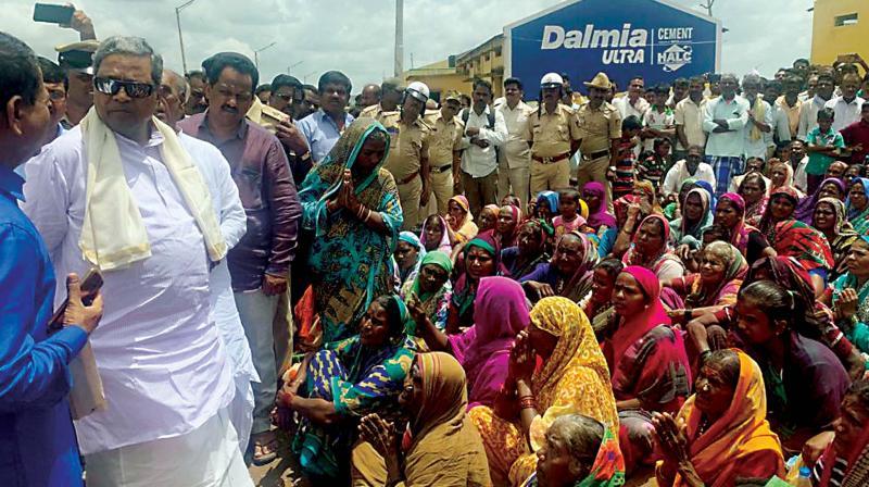 Former CM Siddaramaiah at flood-hit Konnur village in Gadag district on Monday (Photo: KPN)