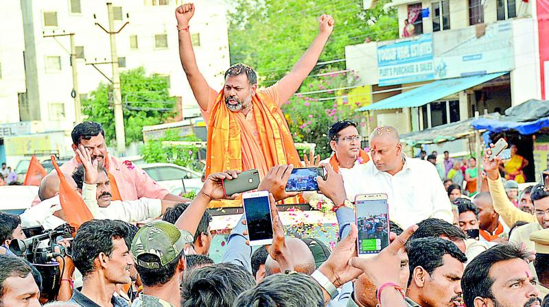 Followers welcome Swami Paripoornananda as he entered the city on Tuesday
