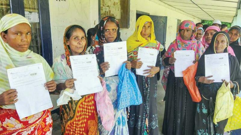 Women queue up to verify their names in the final draft of the National Register of Citizens at Morigoan. ( Photo: PTI)