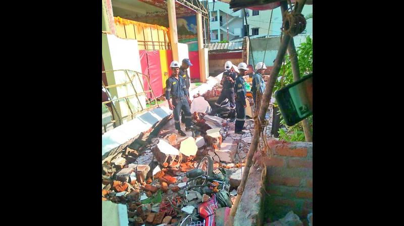 A rescue team clears the debris of the collapsed wall under which four people died, at the Pearl Garden function hall on Sunday.  (Photo: Deepak Deshpande)