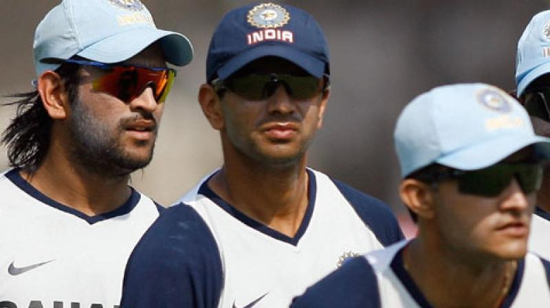 Sourav Ganguly, Rahul Dravid and MS Dhoni. (Photo: AFP)