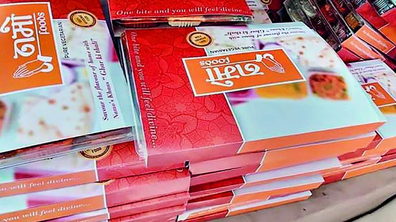 'Namo Foods' packets, which were being distributed outside a polling booth in Gautam Buddh Nagar. (PTI)