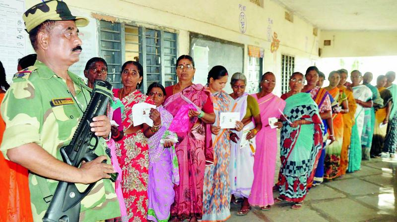 The three officers  were manning booth 244 in Paduvalahippe, Holenarsipura taluk, where Mr Deve Gowda and his family voted  in the elections. (Photo: DC)