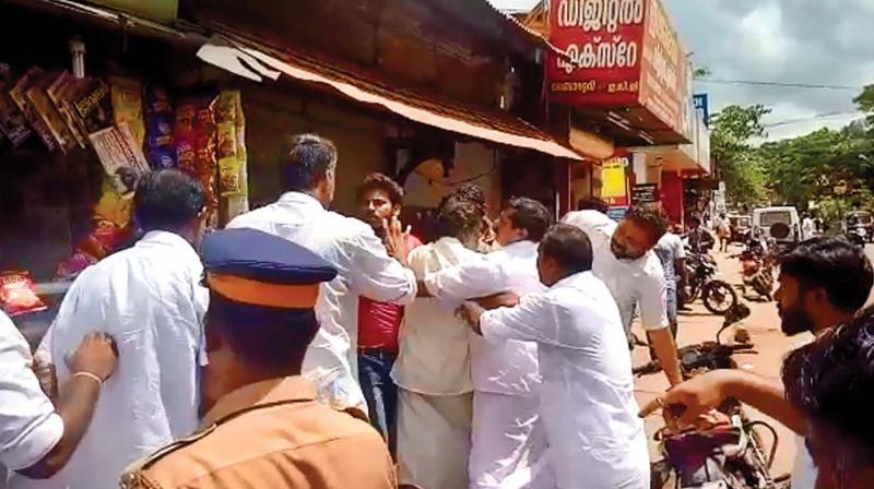 Hartal supporters forcefully shut down a shop at Neyyatinkara.