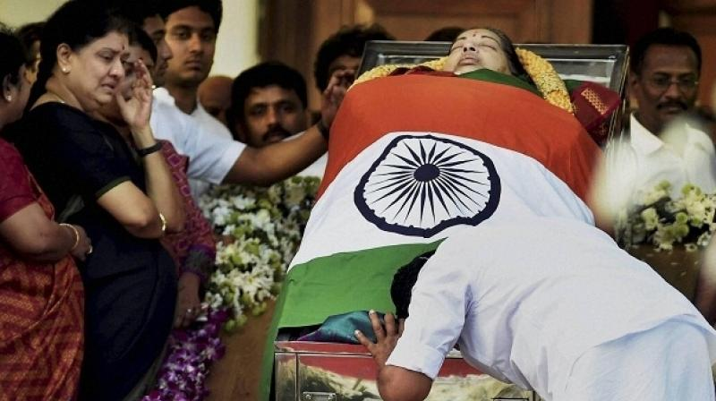 Prior to Jayalalithaa's burial, her body was brought from the hospital to the Poes Garden residence. (Photo: PTI)