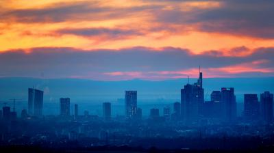 An orange sky enveloping the banking district of Frankfurt, Germany. (Photo: AP)
