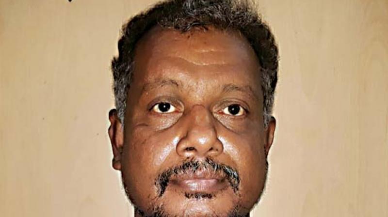 The accused has been identified as T.F. Hadimani, a resident of Vijayanagar in Mysuru.