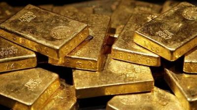 Globally, spot gold was trading lower at USD 1,283.9 an ounce, while silver was down at USD 14.73 an ounce in New York. (Representational Image)
